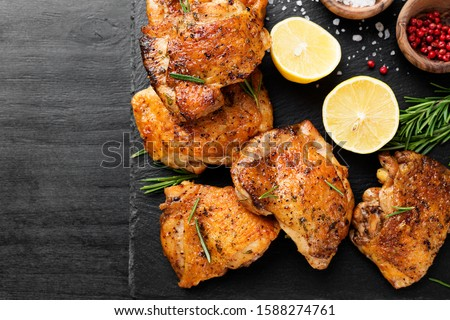 Grilled chicken thighs with spices and lemon. Top view ストックフォト ©