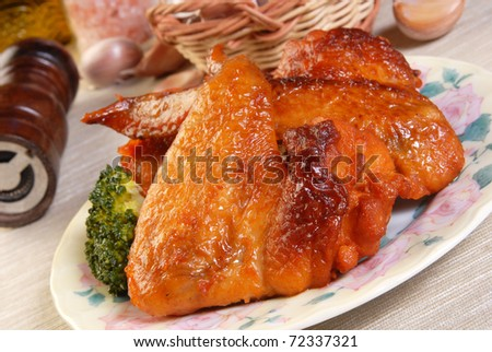 Grilled chicken wings on the table
