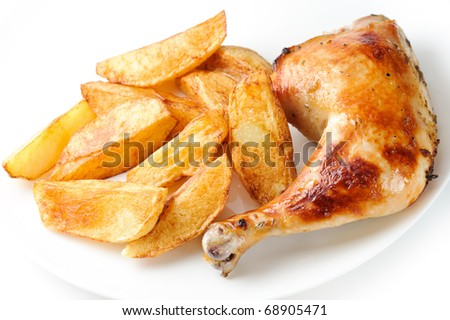 Grilled chicken with potatoes on the plate