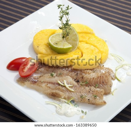 Grilled Codfish With Baked Corn Polenta And Lemon Skin Slices Stock ...