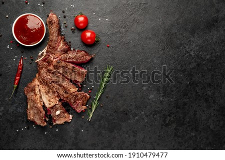 grilled cowboy steak with spices on a knife on a stone background  with copy space for your text Photo stock ©
