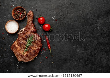 grilled cowboy steak with spices  on a stone background with copy space for your text Photo stock ©