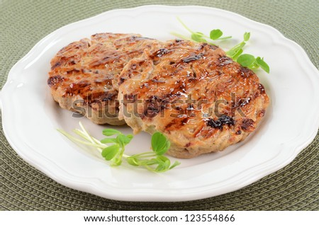 Grilled extra lean turkey burgers brushed with sweet chili sauce