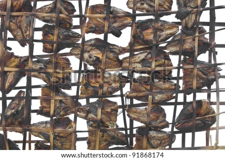 Grilled fish is Drying in a bamboo sieve is the wisdom of Thailand.