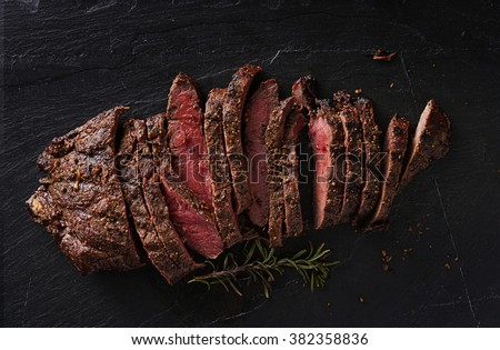 grilled flat iron steak shot in flat lay style from overhead #382358836