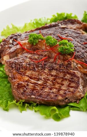 Grilled Foods - Steak on Fresh Salad Leaf