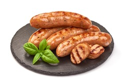 Grilled german bratwurst sausages, isolated on white background.