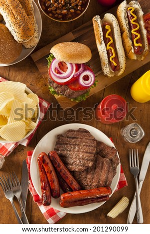 Grilled Hamburgers and Hot Dogs Ready to Eat