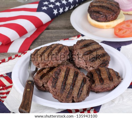 Grilled hamburgers on a plate with flag