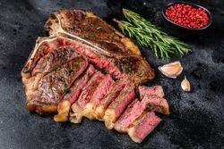 Grilled italian Florentine or t bone beef meat Steak. Black background. Top view.