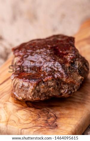 grilled juicy steak on olive wood  #1464095615