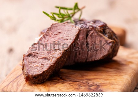 grilled juicy steak on olive wood  #1469622839