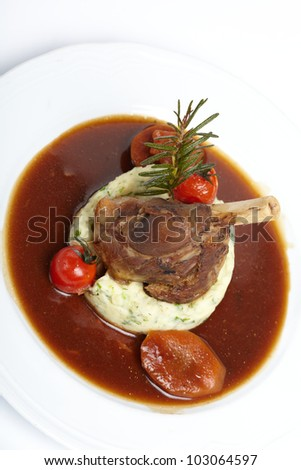 grilled knuckle of pork with sauce - stock photo