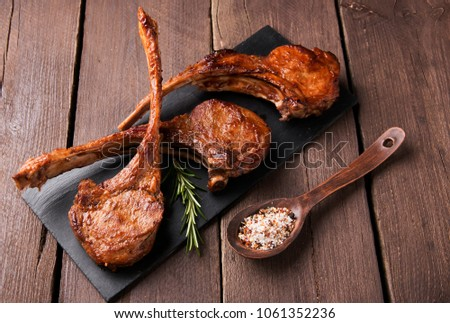 grilled lamb ribs loin  on a stone surface #1061352236