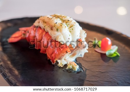 Grilled Lobster and vegetables on plate. #1068717029