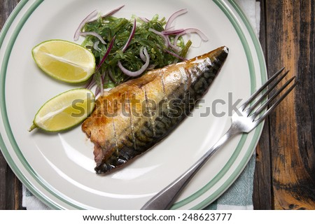 Grilled mackerel fillet with seaweed salad, sesame and lime