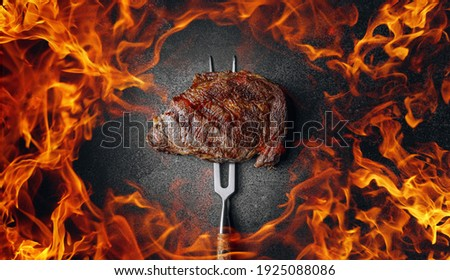 grilled marbled beef steak and fire
