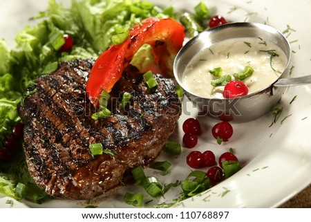 grilled meat in white dish with souce