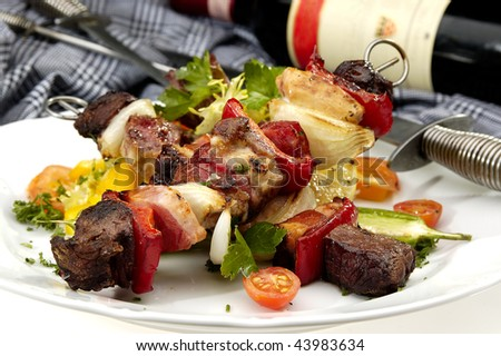 Grilled meat on a spit w vegetable and wine