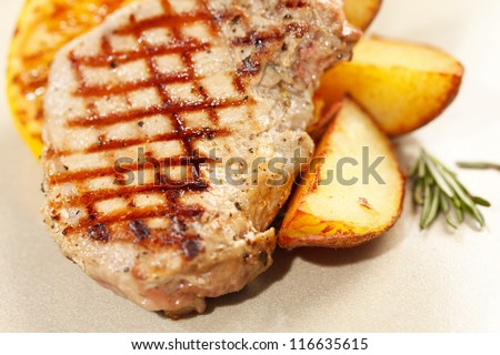 Grilled meat ribs with potatoes
