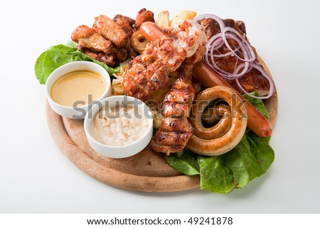 grilled meat sausages on pita bread with vegetables