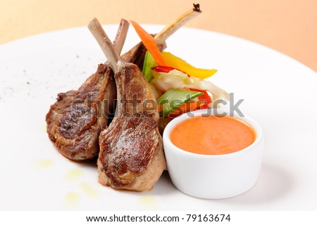 Grilled meat with sauce and vegetable