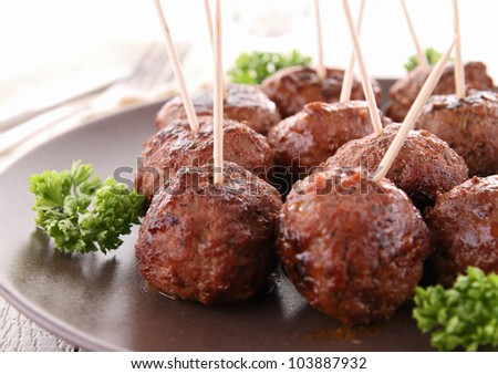 grilled meatballs and parsley - stock photo