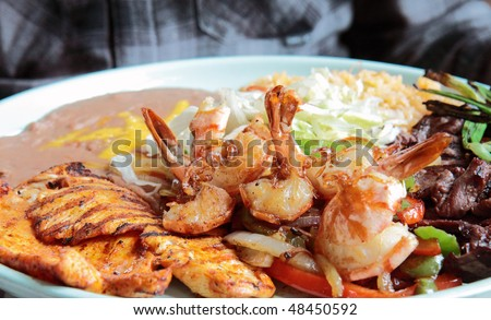 Grilled Mexican platter of shrimp, chicken, and beef