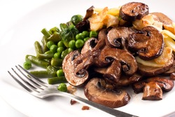 Grilled mushrooms with stir-fried string beans garnished with green peas Lenten meal