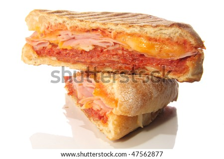 Grilled panini sandwich with ham and cheese.