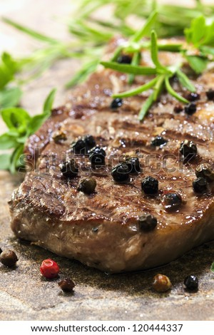 Grilled pepper steak with herbs.