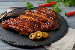 grilled pork ribs on a wooden background