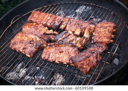 grilled pork ribs on bbq grill with a shallow DOF