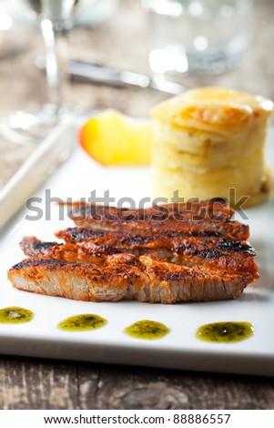 grilled pork steak in stripes