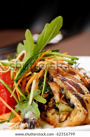 Grilled pork steak with vegetable garnish.