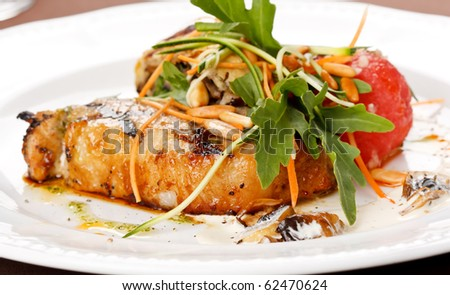 Grilled pork steak with vegetable garnish.