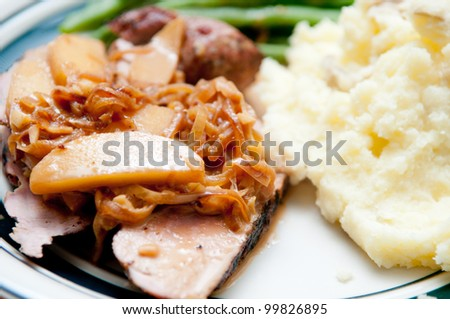 grilled pork tenderloin medallions with apple and sweet onion sauce served with mashed potatoes and green string beans