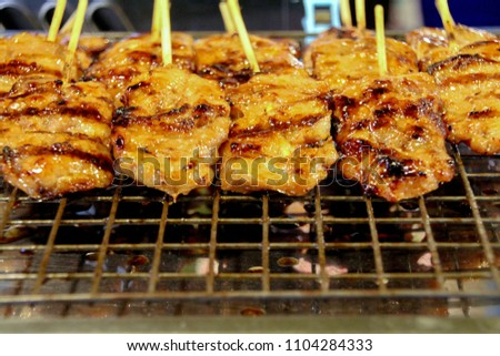 Grilled Pork with Bamboo wooden.There is space for iron grids and rectangular sections of steel grid. #1104284333