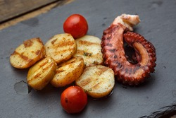 Grilled potato with sea food octopus