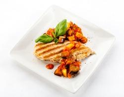 Grilled poultry fillet and vegetables