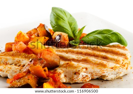 Grilled poultry fillet and vegetables - stock photo