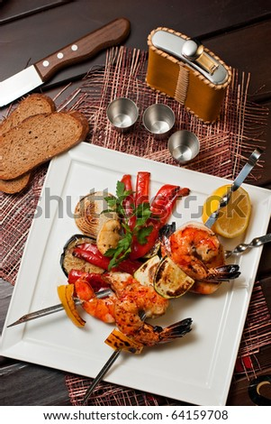 grilled prawns with vegetables on the plate
