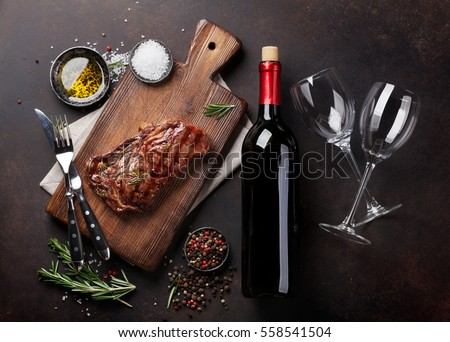 Grilled ribeye beef steak with red wine, herbs and spices. Top view #558541504