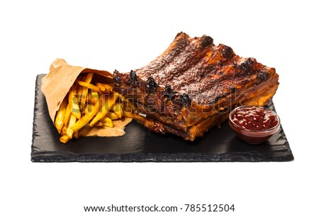 grilled ribs with fries and sauce, white isolated background