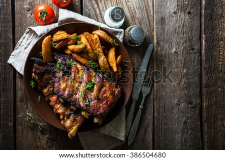 Grilled ribs with potatoes #386504680