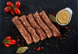 Grilled romanian meat rolls called mititei.Raw traditional romanian mititei