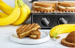 Grilled rye bread sandwich with banana and cream cheese. Delicious healthy Breakfast for adults and children. Selective focus