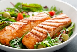 Grilled salmon fillet and fresh vegetable salad. Mediterranean diet.
