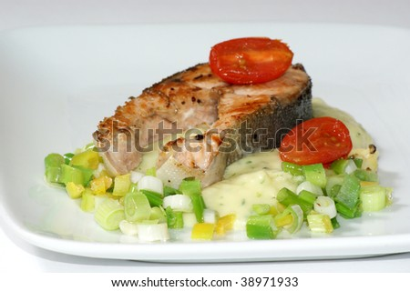 grilled salmon fillet on mashed potato and spring onion
