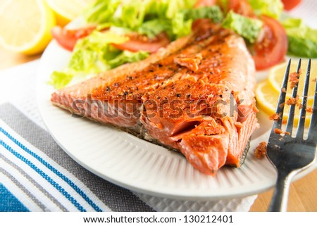 Grilled Salmon Fillet Served with Tomatoes and Romaine Salad